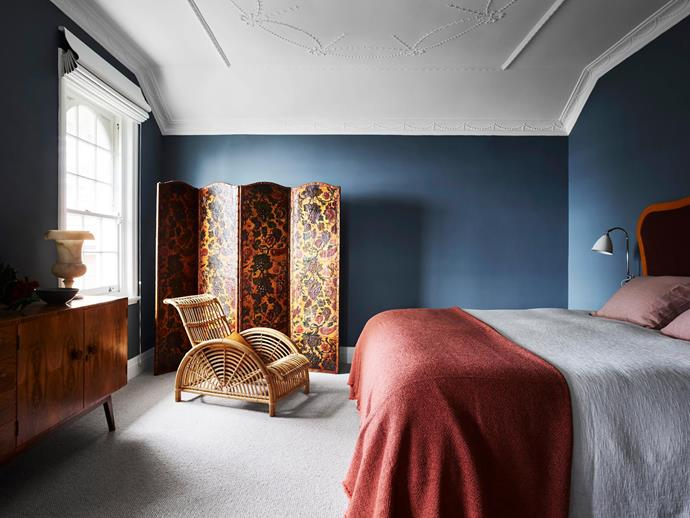 """**Juliette Arent and Sarah-Jane Pyke - Arent&Pyke** <br> Romance fills the air in this main bedroom on the top floor of a Spanish Mission-style apartment building in Sydney's inner east. Only the wonderfully ornate ceiling remained after the Arent&Pyke designers gutted the apartment to enhance the classic architecture and connect with the view. """"With its grand proportions and elevated views, the home has the atmosphere of a Parisian apartment,"""" says Sarah-Jane. Especially in this bedroom, with its ornate ceiling, lush palette, swooping Paris armchair, 19th-century Spanish painted-leather screen and custom 'Princess and the Pea' bed, which """"melds the clients' love of antiques, yet still feels modern"""", says Sarah-Jane. The well-travelled owners might stay put more often now. """"We have fallen in love with the whole notion of home,"""" they say."""