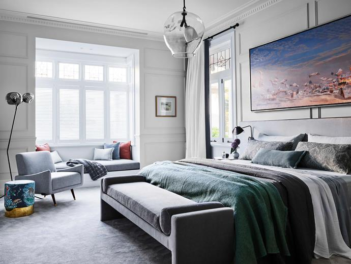 """**Alexandra Donohoe Church, Marie McGarva and Kirstin Tarnawski - Decus Interiors** <br> This bedroom offered the interior designers plenty of inspiration. A soothing, luxe aesthetic was the prime request of the owners, who wanted an escape from the bustle of the family-centred communal areas. """"It's designed as a retreat, hence the sophisticated colour palette, luxe fabrics and glam finishes,"""" says Alexandra. """"The home's heritage detailing was a constant source of inspiration."""" The room is adjacent to a small lobby that adjoins a rather masculine study; the soft textures and muted colours in the bedroom suite are a delightful counterpoint"""