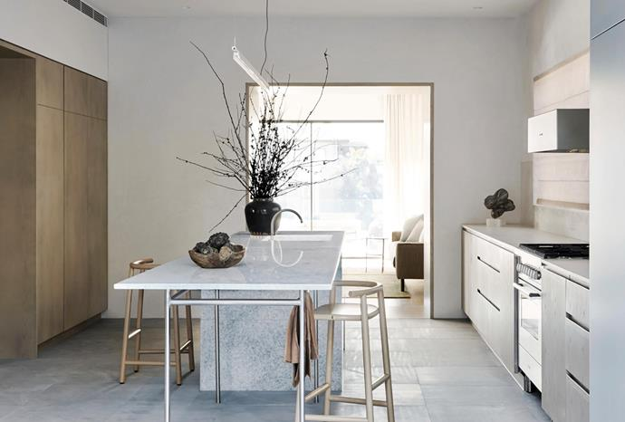 """**Anna Trefely - Esoteriko** <br> The existing kitchen was under-scaled for this home on Sydney's Lower North Shore. And, sliced off from the living spaces, it didn't encourage lingering. Anna gutted the room then enlarged the openings to create a sense of flow. To make the space more functional, she included a large island that doubles as a dining table, plus storage on both sides of the room. """"The detailing is clean and simple,"""" she says. """"It takes its cues from Japanese design but uses local materials for context."""" The blue marble, for example, has a crystalline appearance that evokes the ocean. The owner agrees: """"The materials engender the space with calm sophistication""""."""