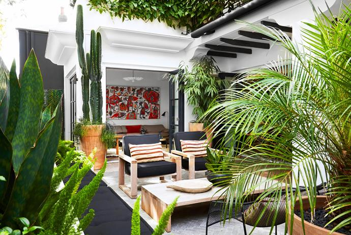 """**Justine Hugh-Jones and Katrina Mackintosh - Justine Hugh-Jones Design** <br> The owners' love of Marrakesh spurred interior designer Justine-Hugh Jones to create a Moroccan-inspired courtyard in Sydney's east, a collaboration with Garden Life. """"The brief was for a contemporary family home that felt both stylish and appropriate in its setting. The outdoor room was key to meeting the brief,"""" says Justine. It features Moroccan zellige tiles laid in a herringbone pattern (on rear wall), which tie in with the surrounding foliage. Once a dark and unloved area, this is striking, light-filled space is now a favourite haunt. The design also provides valuable privacy from the street."""