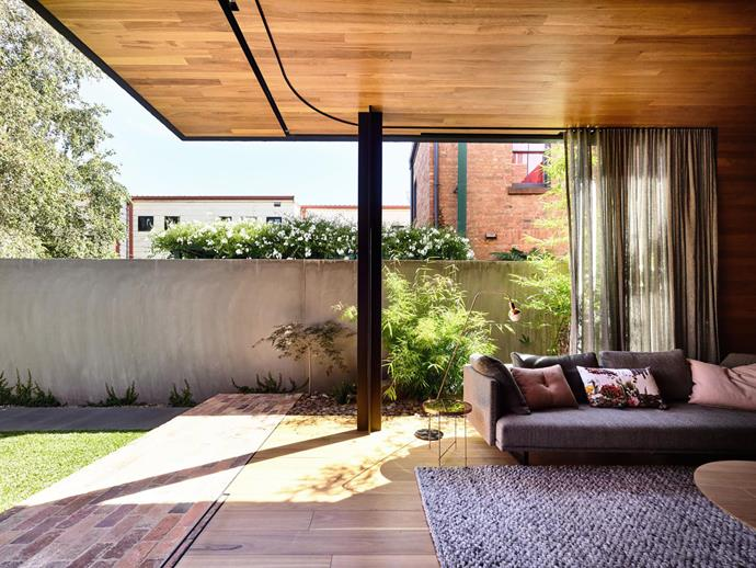 """**Matt Gibson and Karen Batchelor - Matt Gibson Architecture + Design** <br> Taking the concept of the indoor-outdoor connection to a whole new level, the walls in the rear living room of this Melbourne home can disappear altogether. When the sun is shining and the temperature is balmy, the owners simply slide the vast doors and breathe easy. """"The openness of this space, a rear living area suits the family's lifestyle and brings the garden inside,"""" says Matt. The room is a symphony of natural materials: oiled blackbutt on the floor and ceiling is paired with recycled bricks at the threshold. """"This area enables a visual exhaling and an immediate sense of light, air and space,"""" says Matt."""