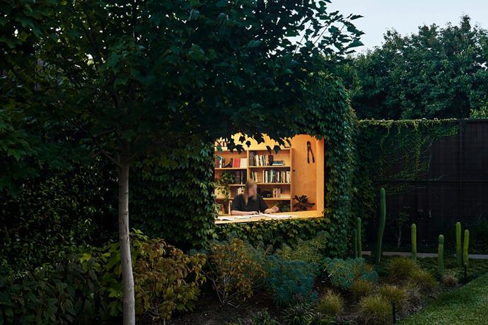 """**Matt Gibson & Karen Batchelor - Matt Gibson Architecture+Design** <br> Nestled in the corner of a Melbourne garden, cloaked in Boston ivy and surrounded by greenery, this study/writer's shed is a dreamy workplace for the resident writer. Matt and his team designed the cosy retreat, located in a formerly under-utilised corner of the block, as a timber-framed structure with waterproof plywood cladding, overlaid with a wire grid to train the ivy. Inside, it's lined with ply and the finishes are deliberately restrained, extending to slimline bookcases, objets d'art and pot plants. The desk is built into a generous picture window that frames the garden view. """"The shed is at one with the landscape – a living part of the garden rather than an imposition on it,"""" says Matt. """"This room gives me a genuine sense of peace, security and calmness,"""" says the owner. """"I work, read, build things and play musical instruments in here."""""""