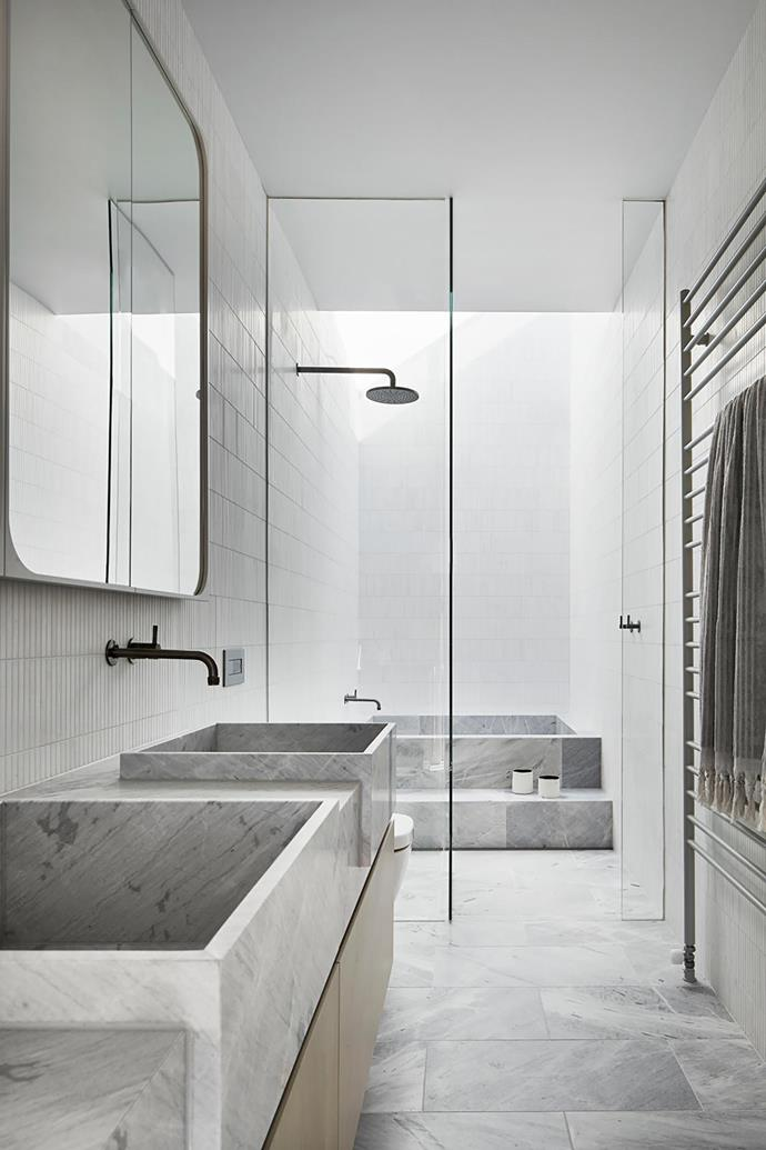 **Chris Rak & Katherine Robson - Robson Rak Architects & Interior Designers** <br> This Melbourne bathroom is a perfect example of the impact a restrained colour palette and natural materials, used creatively, can have. The bath is formed from Elba marble and located just beyond the shower; you step up into the bath then down. Above the bath is a generous custom-designed skylight: the owners' favourite element. The marble and wall tiles were chosen in tones that emulate clouds, so the whole experience feels like one is floating in the sky.