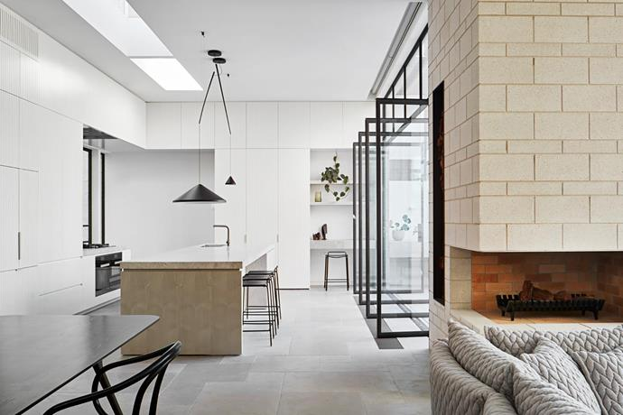 **Chris Rak & Katherine Robson - Robson Rak Architects & Interior Designers** <br> Texture, tone and robustness are key to this beautiful Melbourne kitchen, part of a major renovation of a double-fronted Victorian home. The new kitchen has become the heart of the home; the owners love its connection to the outdoors and the natural light that shines in. The generous island is a multipurpose space, ideal for meals, food prep, homework, and serving when entertaining. There's ample storage in the routed joinery, including dedicated cupboards for each child, so art materials, homework and other bits and pieces are handy – and can easily be put away.