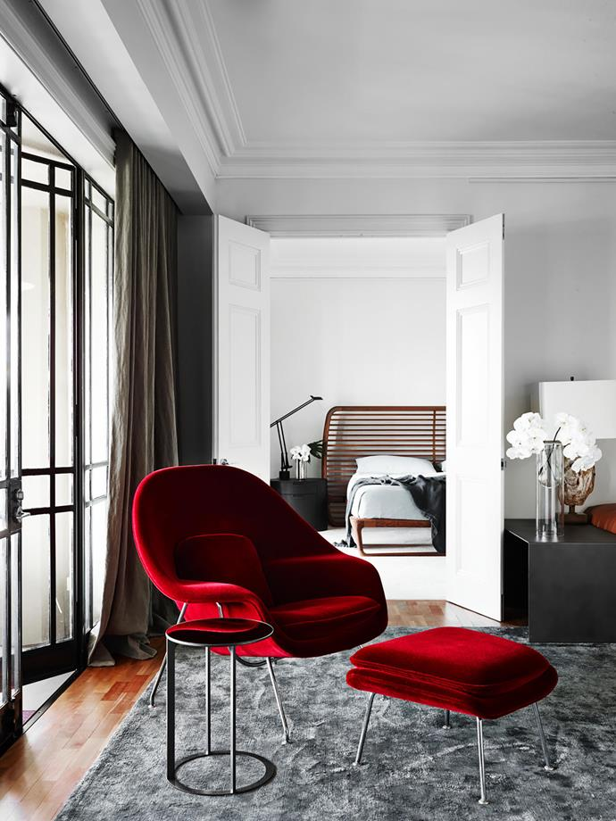 """**Sarah Davison - Sarah Davison Interiors** <br> When your client is passionate about fine wines, it makes sense to build a room around his love of a robust red. """"The deep-red velvet chair and ottoman are beyond luxe,"""" says Sarah. They deftly address the owner's request that she transform his inner-Sydney apartment, into a luxe and sophisticated city pad. """"He wanted this space to feel comfortable and convivial."""" The renovation encompassed refurbishing the floor and refreshing the decor with new lights, window treatments and furniture. The new elements really pop against the background of Dulux Natural White wall. """"This warm, urbane space now gets a lot more use,"""" adds Sarah."""