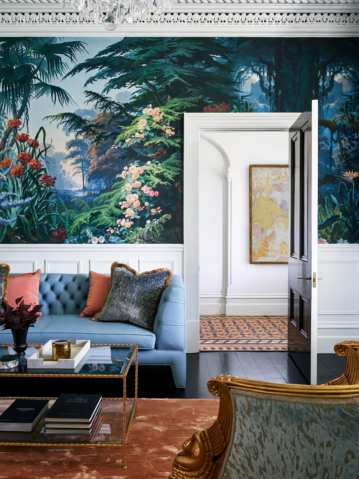 """White wainscoting anchors the florid statement wallpaper in [this Sydney living room](https://www.homestolove.com.au/house-and-garden-top-50-rooms-finalists-2019-20775