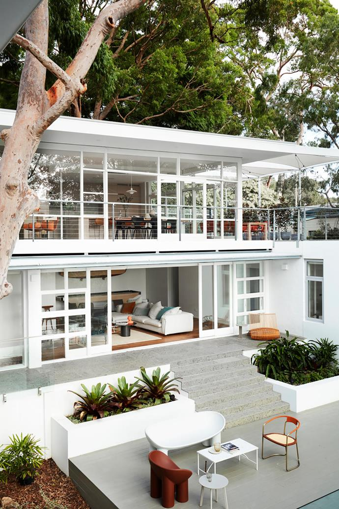 """**Suzanne Gorman** <br> This 1959 Modernist home in Sydney, by architect Glynn Nicholls, provided a rich vein of design inspiration. The first task was painstakingly restoration of the original features, followed by updating the interiors, which take cues from both the architecture and its bushland setting. """"We also played with colour, referencing Mondrian palettes – primary colours and white – teamed with limed and oiled American oak,"""" says Suzanne. She also referenced the landscape, a feature scribbly gum in particular, in her refresh of outdoor areas. Natural stone is used extensively throughout."""