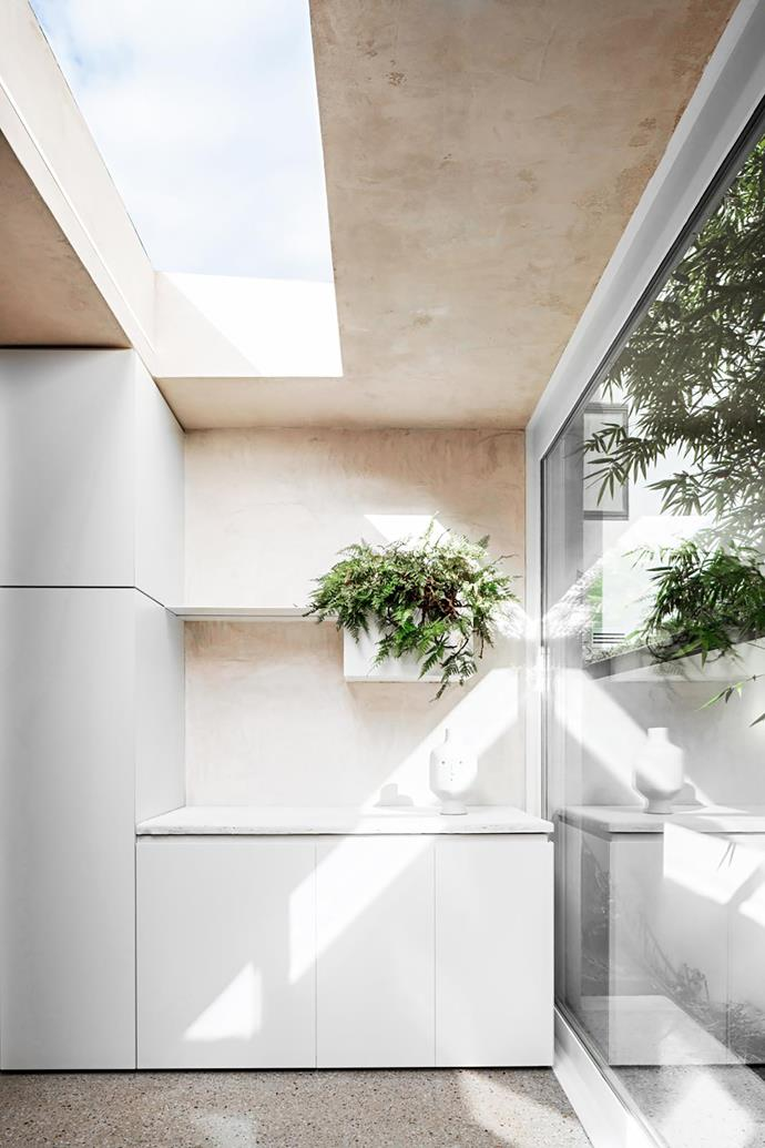 """**Melanie Beynon, Alis Garlick and Tama Abeynaike - Melanie Beynon Architecture & Design** <br> Melanie and her team looked overseas for inspiration when designing this 15x15m extension to a Melbourne 1930s cottage. """"Courtyards in Spain are often quite compact, so they are designed to maximise sunlight,"""" says Melanie. This light-drenched room is sheltered from the elements and a neighbouring development. The Spanish influence can also be seen in the rustic finishes, which deliver textural variation and warmth, day and night. While it's primarily a breakfast room, laundry utilities are concealed in the cabinetry – a smart use of space."""