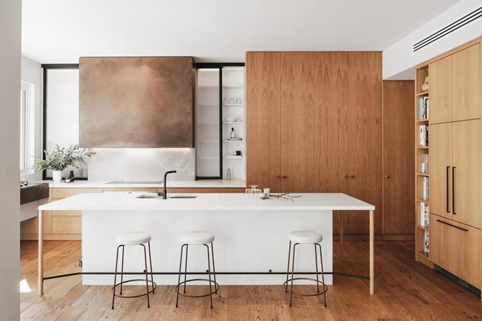 """**David Burton, Sophia Leopardi, Rachel Catt and Kate Schapel - Willams Burton Leopardi** <br> The owners of this Adelaide home, a family of eight, had two key requests – storage and space. """"If The Brady Bunch taught us anything, it was that a blended family needs space… a place for everything and everything in its place,"""" says the owner. Williams Burton Leopardi began by resolving poorly connected spaces, including the kitchen, which was relocated to a sunnier part of the house. Excellent use has been made of materials – Calais marble, timber, formed concrete, brass and bronze. """"It's a relaxed and totally functional area where our large family often congregates,"""" says the owner, Kate. """"There's also sufficient space for quiet contemplation when required."""""""