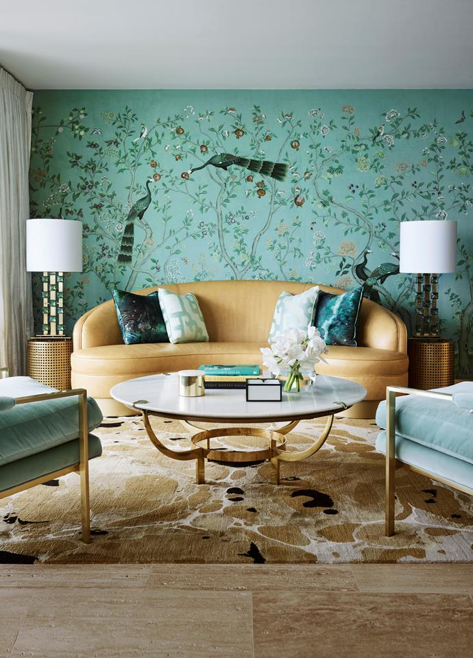 """**BEST USE OF COLOUR SPONSORED BY ARMADILLO & CO: GREG NATALE**<br> With its bold peacock wallpaper, this living room in Sydney's east really struts its stuff. """"In a new penthouse, the clients wanted us to layer the space with pattern and texture to create a sense of warmth in contrast with the modern build,"""" says Greg. Drawing inspiration from a Ray Cook painting already owned by his clients, he opted for an exuberant design with a touch of luxe."""