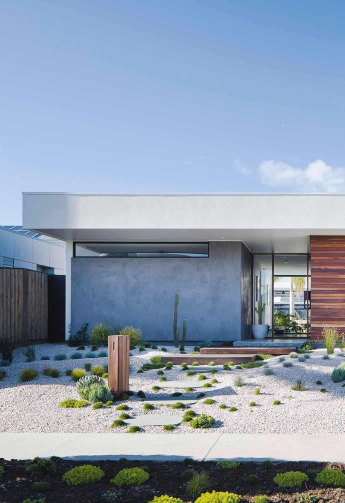 """The exterior of this [Palm springs-inspired home in Casuarina](https://www.homestolove.com.au/palm-springs-inspired-home-19646