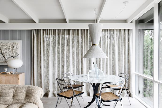 Simone uses the marble table, in the area that was previously the balcony, as a styling surface. The vintage dining chairs are from Angelucci 20th Century and Simone had the light shade custom made based on one she saw overseas.