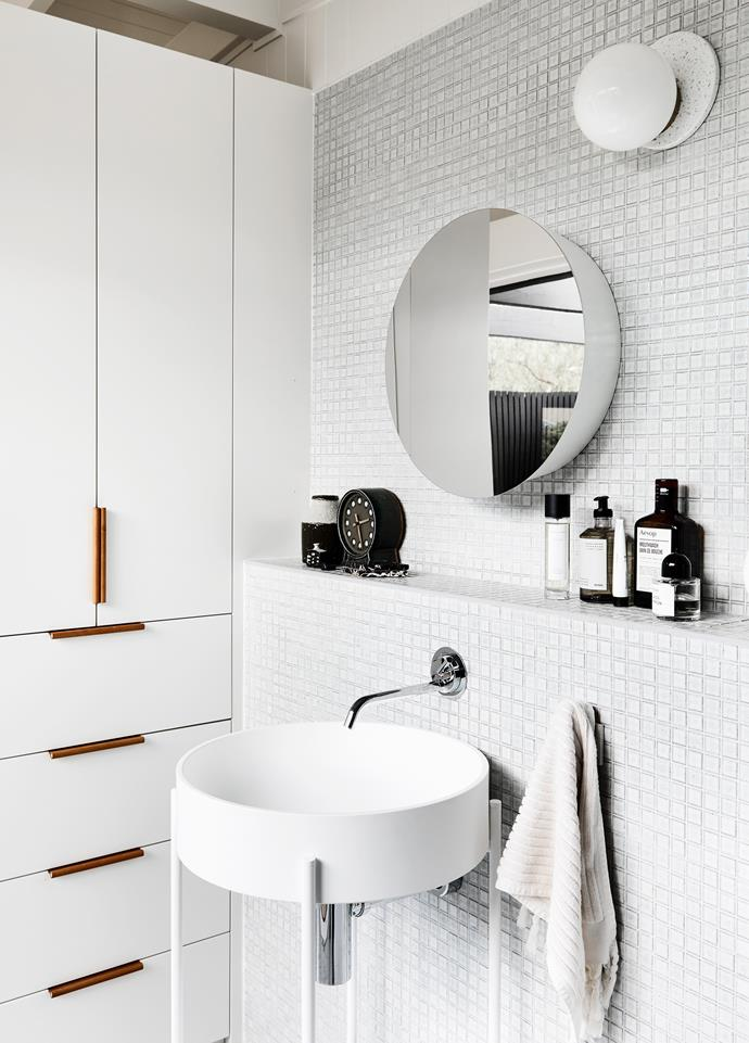 The ensuite's clever cabinetry by Sarah Reid provides plenty of storage in a small space.