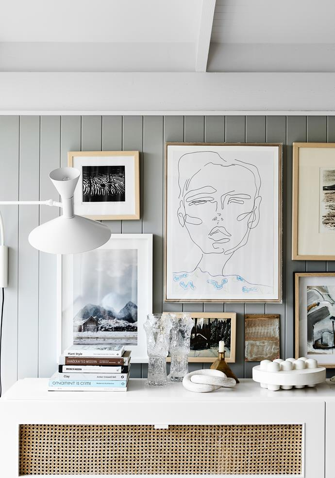 Sarah Reid at S R & O custom-designed the rattan cabinetry, while the artworks are a combination of op-shop finds and pieces by  the likes of Erin Armstrong and Sam Shmith.