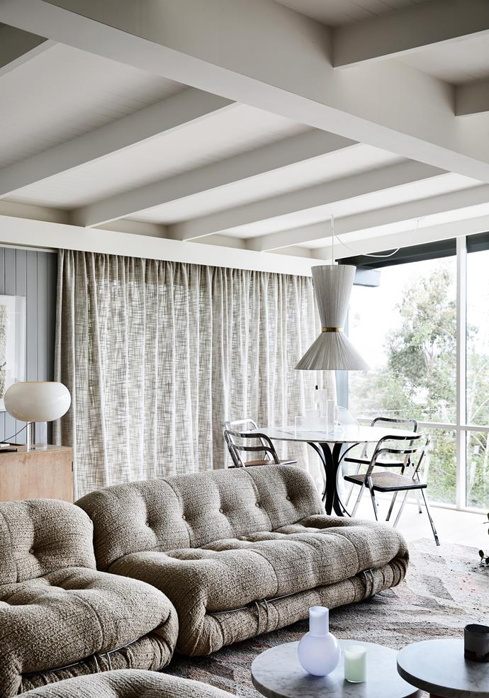 Vintage Cassina 'Soriana' sofas, Boyac linen curtains and a large rug from Loom add to the cosy feel in the living space.