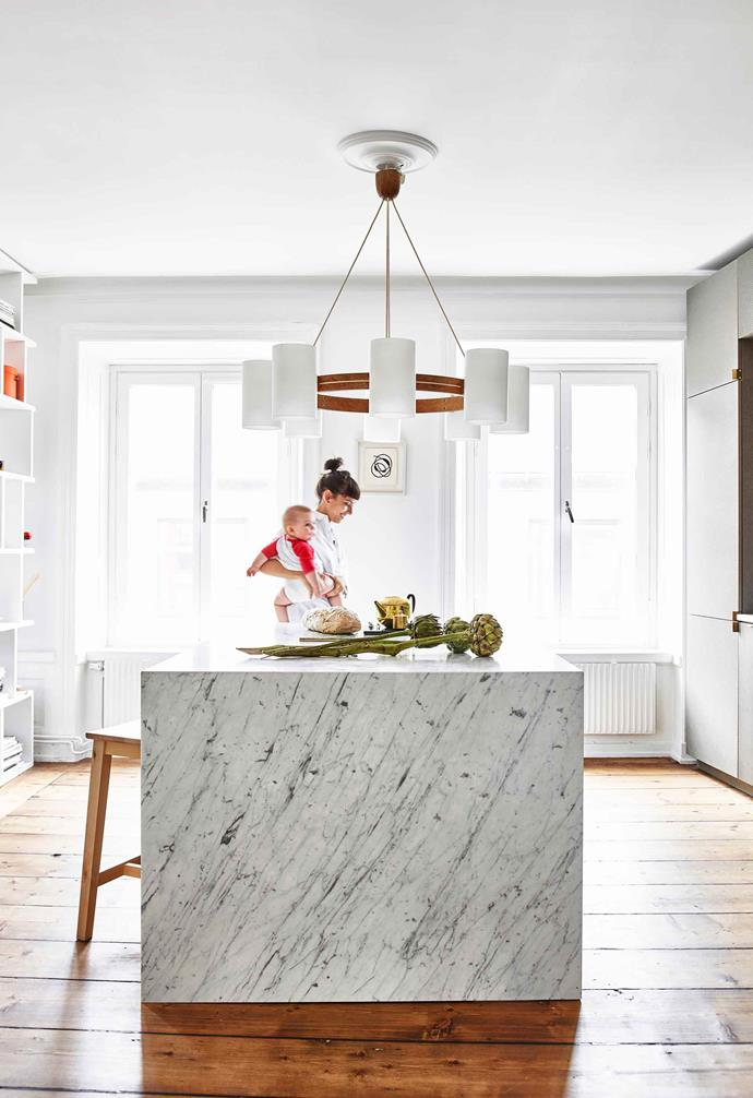 """**Kitchen** Natalia and Marcus wanted a big marble [island bench](https://www.homestolove.com.au/kitchen-inspiration-13-of-the-best-island-benches-17943