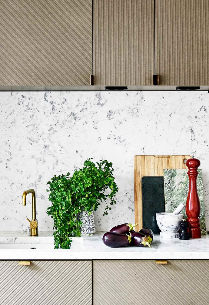 **Kitchen** The custom cabinetry with grooved features was inspired by the graphic work of artist Sol LeWitt. Natalia and Marcus bought the cutting board in Japan.