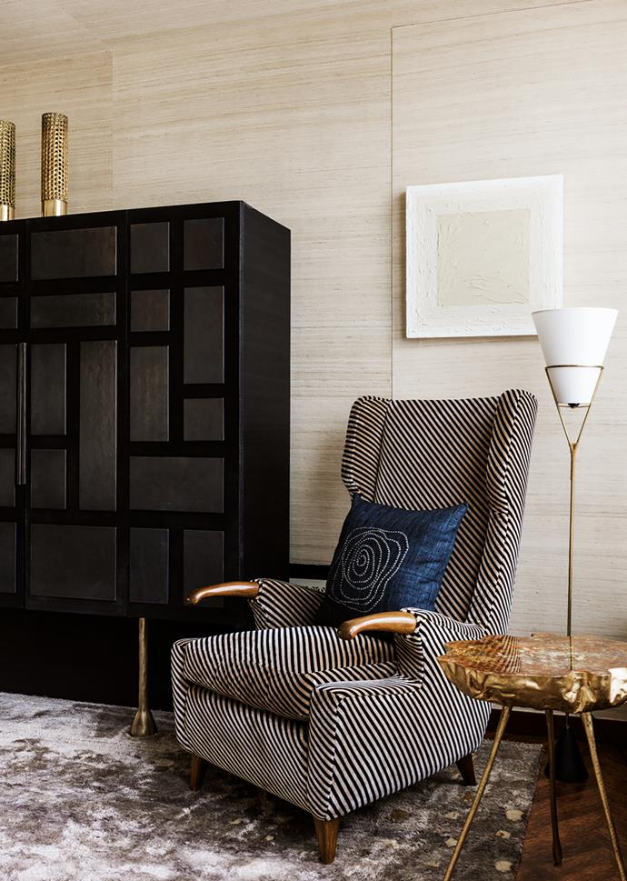 Custom TV cabinet in ebonised oak holds brass lamps by Pierre Forssell. Armchair was designed by Pier Luigi Colli and reupholstered in a Kelly Wearstler fabric. Oil painting by Russell Tyler. Carl Auböck floor lamp. Hélène de Saint Lager resin table.