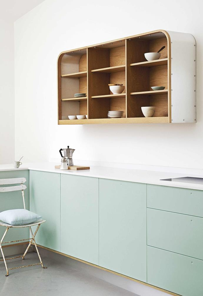**Bending the rules** Don't take up extra head-height space with the opening and closing of cupboard doors. In this clever design by UK designers DeVOL, open wall-hung shelving provides easy access storage and cupboards below hide appliances. Retro style and modern utility!
