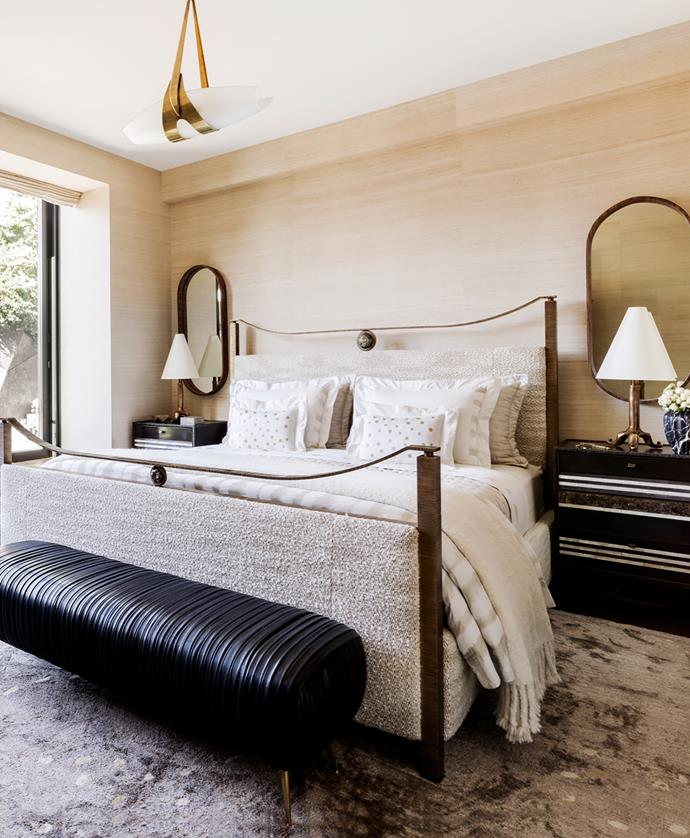 Custom bed in bronze. Kelly Wearstler 'Souffle' bench. Custom bedside tables in bronze, walnut and mother of pearl with Garouste & Bonetti lamps. Custom Mongolian cashmere rug. Brass and glass ceiling light is a 1950s design by Max Ingrand.