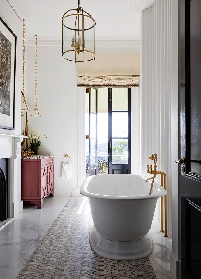 With a nod to its past, this bathroom's original features have been restored to their former glory by Thomas Hamel and Becky Yager with added art deco tributes that result in a room that has a feel of global elegance.
