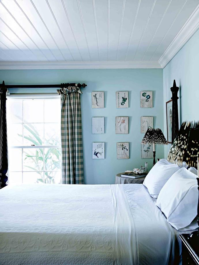"Chinese botanical paintings line the bedroom walls, which are painted a custom-mixed colour. ""I'm always marrying the sea and the garden, and that's just in here,"" she says. ""I repeat this throughout the house."""