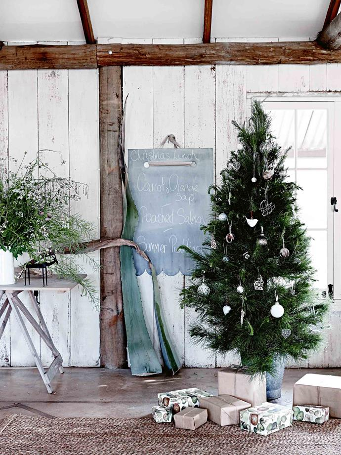 "This year, the old dairy has been chosen as the setting for the [Christmas tree](https://www.homestolove.com.au/4-christmas-tree-decorating-styles-4397|target=""_blank""): ""Simple, bright, a bit rustic and fresh, with seedhead flower arrangements, and brown paper packages tied up with string, interspersed with quail- and duck-egg paper,"" explains Mickey."