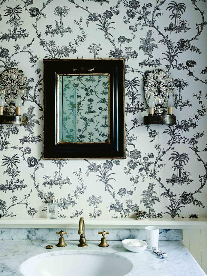 A mirror from England offsets the 'West Indies Toile' wallpaper from Brunschwig & Fils. The Robertsons spent their first night at Glenmore House in November 1989, but adding additional wings, and turning it into a four-bedroom house with extra bathrooms, took time. It wasn't until 1995 that they moved in permanently.