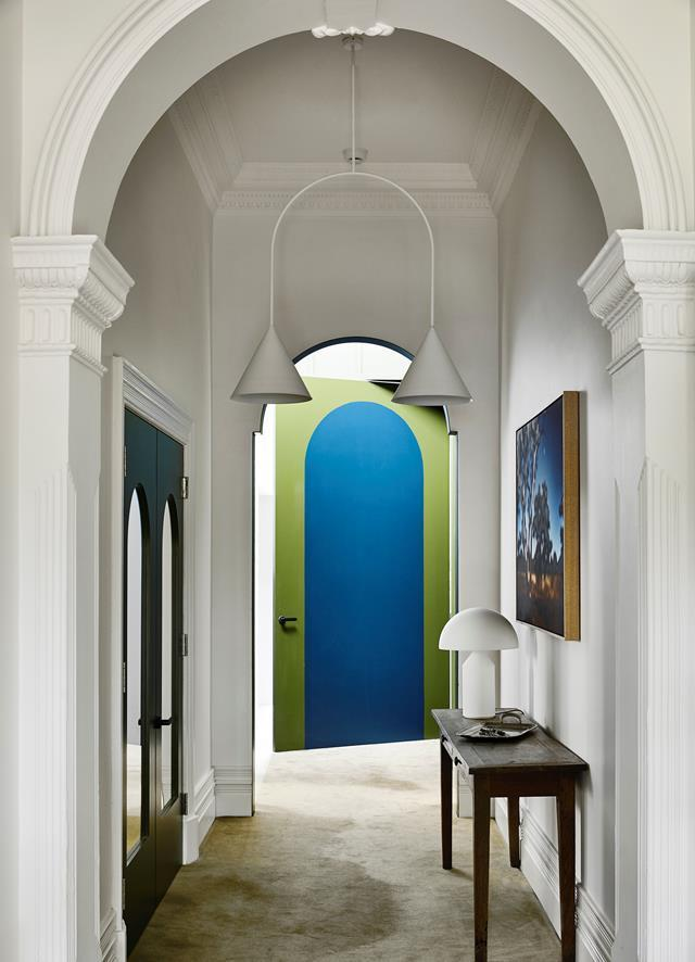 "Edwardian details sit comfortably alongside modern designer pieces in this [revamped heritage home's](https://www.homestolove.com.au/heritage-home-bold-revamp-20426|target=""_blank"") elegant hallway conceived by Kennedy Nolan."