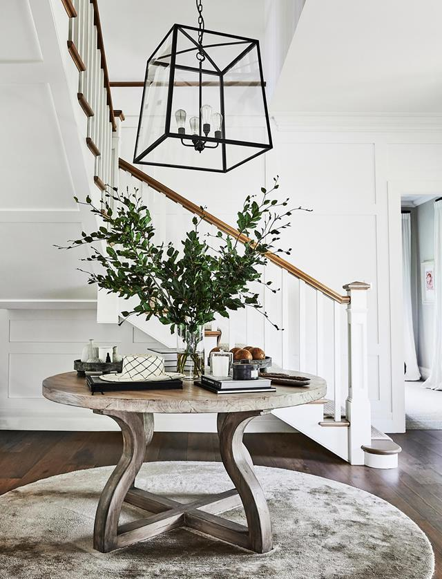 """The main architectural gesture was to create one large double-height entry foyer out of two small existing rooms, with a new staircase and custom Jacobean-style panels to convey a sense of grandeur,"" says Tania Handelsmann and Gillian Khaw of this [Federation terrace](https://www.homestolove.com.au/federation-terrace-sydney-filled-with-worldly-treasures-19960