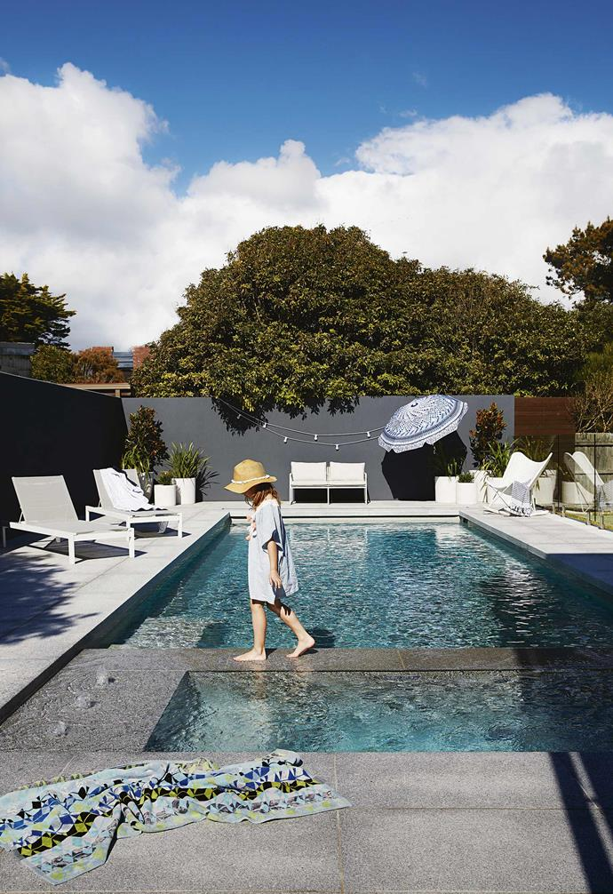 This swimming pool us subtly divided into two with the spa section including a playful water feature, making the pool the highlight of outdoor entertaining during the summer.