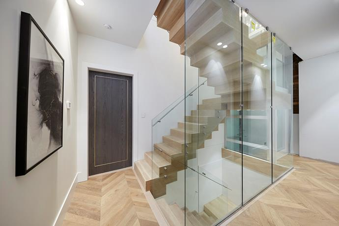 Jesse and Mel's stairwell and stunning parquetry flooring.