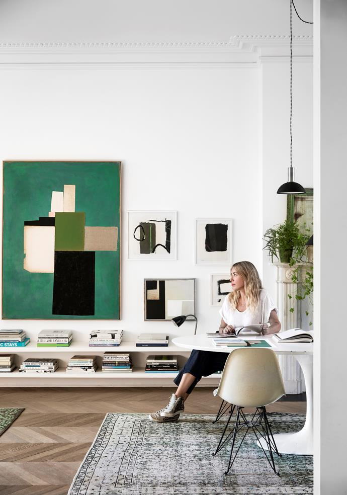 """I've always been a maker and painter. It's my outlet; like being lost in a good book,"" says Liza, pictured. ""I'm addicted to green – as you can see. My favourite painting at the moment is the green work in my living room above the bookshelves."""