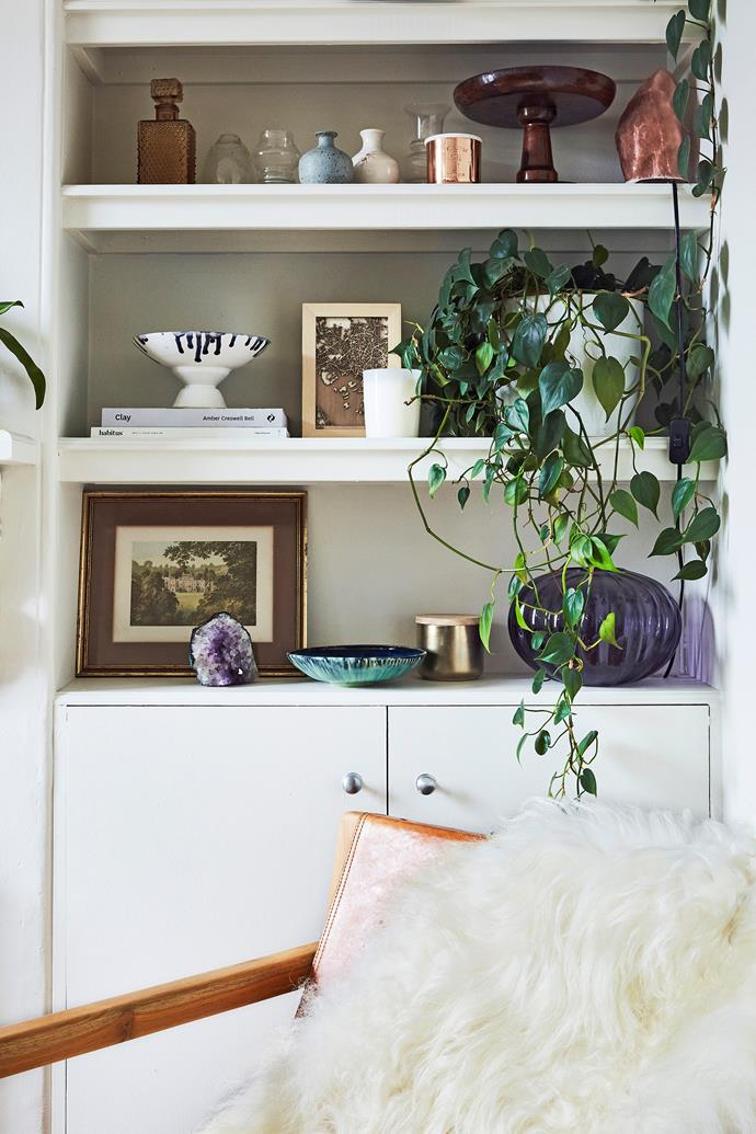 "[Trailing Devil's ivy](https://www.homestolove.com.au/trailing-indoor-plants-12481|target=""_blank"") (Pothos) and colourful vintage wares bring this cosy corner to life."