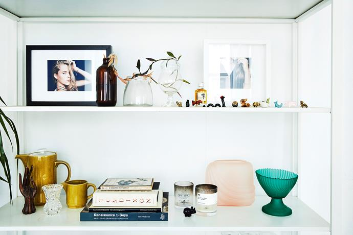 Collected curious and treasured photos create a beautiful vignette.