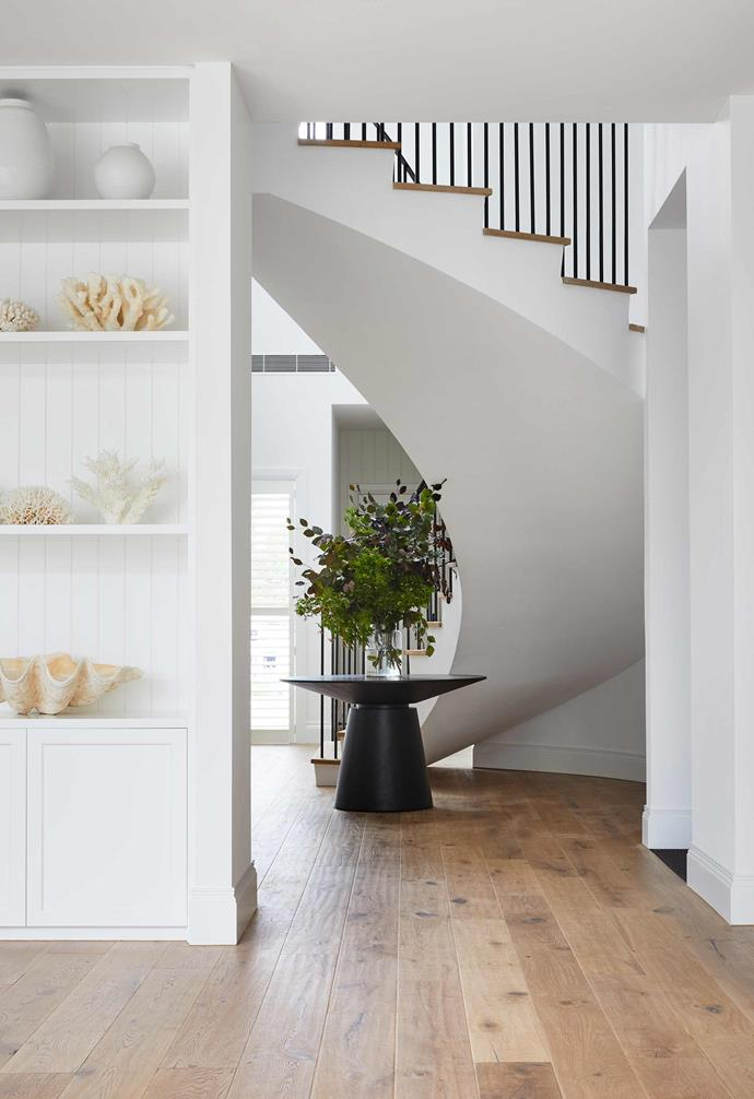"**Entry** Once inside, visitors are greeted by a grand staircase and an oak-veneer Classique table from [Big Chair](https://bigchair.com.au/|target=""_blank""