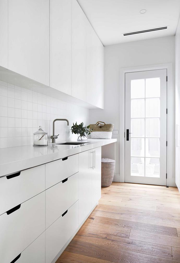 "**Laundry** White wins out again, with small details such as stainless-silver tapware and open drawer pulls as points of difference. Square white tiles make a simple but effective splashback. Cabinetry in [Dulux](https://www.dulux.com.au/|target=""_blank""