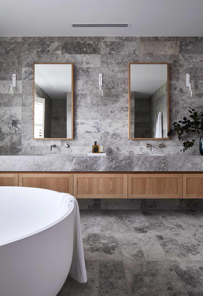"**Ensuite** In a home of great features, these grey Tundra 600mm x 200mm limestone tiles sourced by [KWD](https://www.katewalkerdesign.com.au/|target=""_blank""