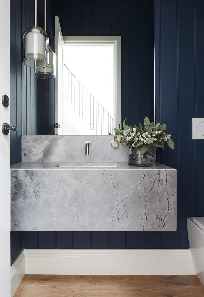 "**Powder room** The integrated basin is Super White Dolomite marble, which also features in the main bathroom. V-grooved ply panels in [Dulux](https://www.dulux.com.au/|target=""_blank""