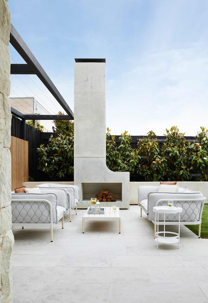 "**Exterior** Outdoor entertaining in winter is a pleasure with this open fire and chimney by CK Formwork (from a Nathan Burkett design). Tait 'Trace' lounge, armchairs and coffee table with a 'Lily' side table, all from [Coastal Living](https://coastalliving.com.au/|target=""_blank""