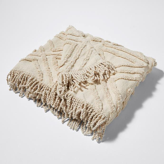 "Amira Tufted Textured Throw in Natural, $39, [Target](https://www.target.com.au/p/amira-tufted-textured-throw/62128919|target=""_blank""