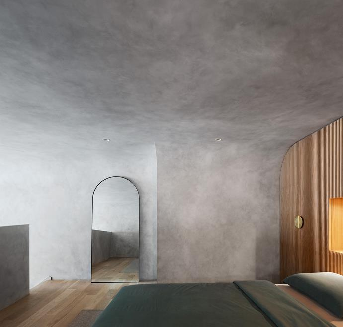 In a raw and imposing space such as this, softness is key, and can be achieved without resorting to the usual cushions and throws. The rounded shape of this mirror, er, mirrors the curves in the ceiling, with the circular theme continuing in the furniture, lights, door handles, even the kitchen island.