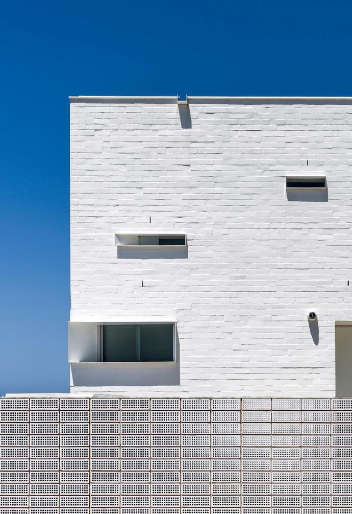 """**Exterior** From the street level the home features a discreet yet striking palette of white bricks and unglazed terracotta [breeze blocks](https://www.homestolove.com.au/breeze-block-wall-ideas-20511