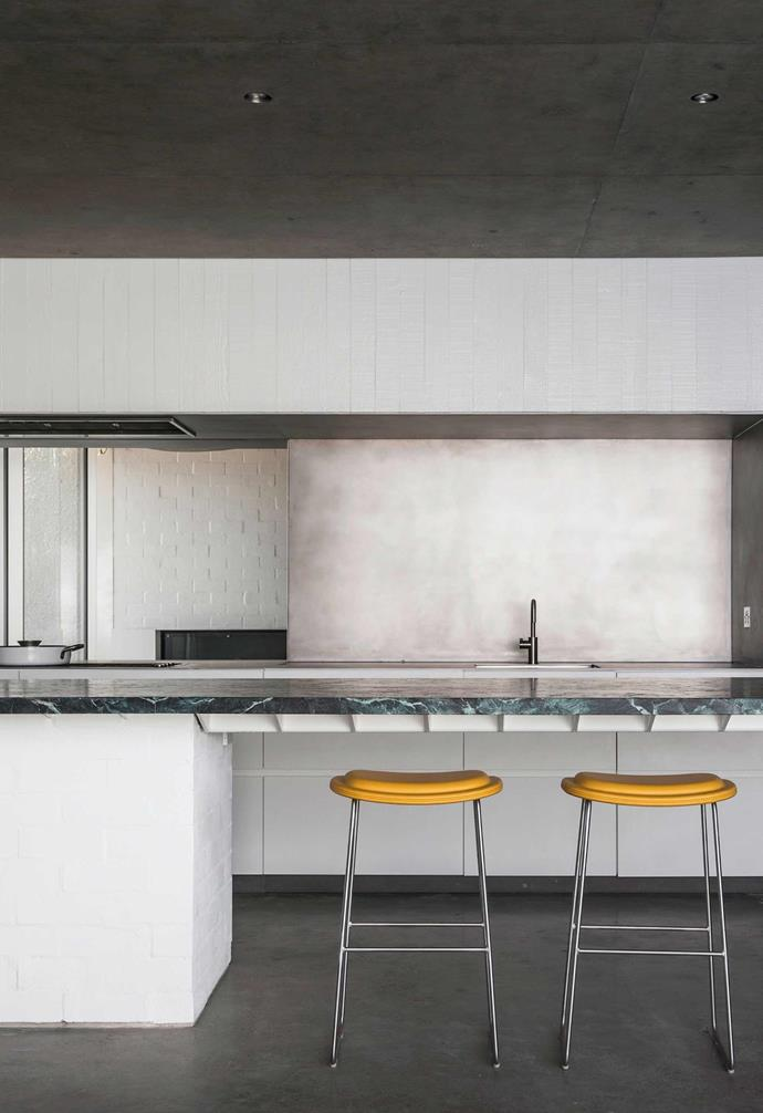 """**Kitchen** The kitchen features a neutral palette that pairs  a striking green marble [kitchen benchtop](https://www.homestolove.com.au/kitchen-inspiration-13-of-the-best-island-benches-17943