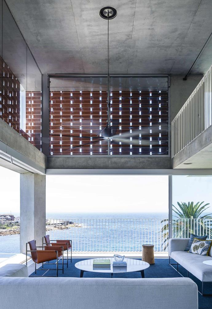 """**Living** Divani sofas, a Poliform coffee table, Poltrona Frau armchairs and a Paola Lenti rug fill the [open-plan living room](https://www.homestolove.com.au/20-best-open-plan-living-designs-17877