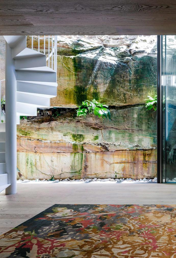 **Lower level** The lower level features a music room and cellar alongside an exposed sandstone rock face that instantly adds character to the floor.