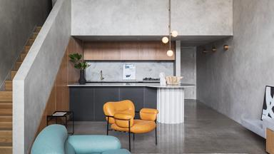 A Brutalist style apartment with a cave-like concrete interior