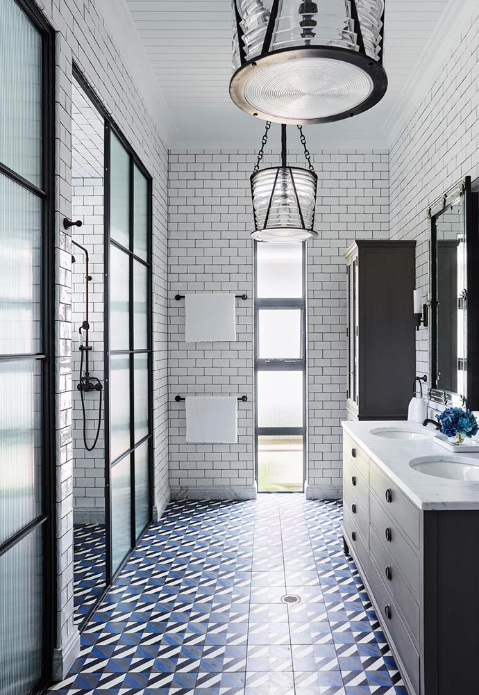 Greg Natale 'Verona' floor tiles for Teranova. 'Amano' wall tiles from Academy Tiles. 'Chatham' pendant lights from Ralph Lauren. Vanity with Carrara marble top from RH. Photograph by Anson Smart.