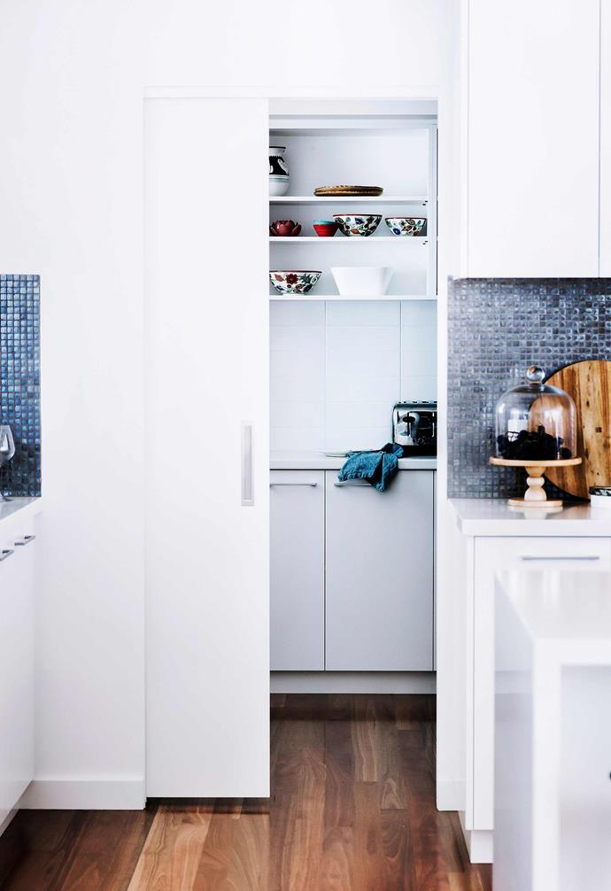 Open shelving gives you a chance to display treasured pieces, as well as keep entertaining essentials at hand while a sliding door will help keep your kitchen visually clutter-free.