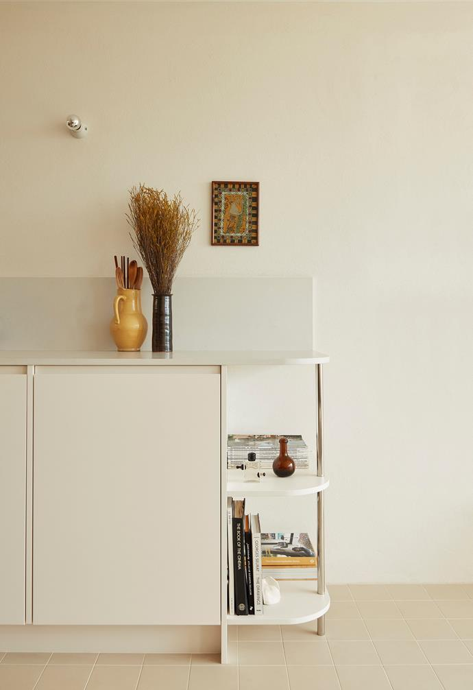 The curved shelf is a handy spot for displaying art books, magazines and vases.